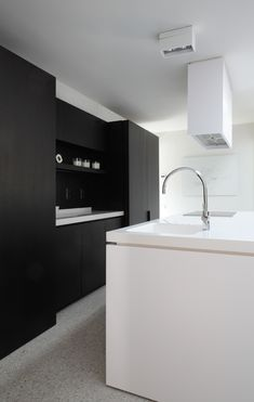 Black and white kitchen designed by Co Studio _
