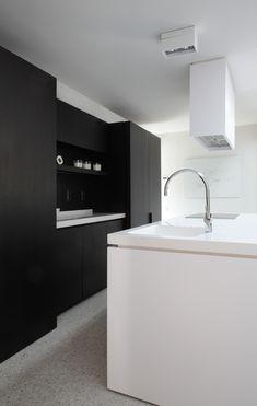 Black and white kitchen designed by Co Studio _