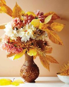 With the bounty of fall foliage and the colors of autumn, you can put together beautiful, colorful arrangements you can't make any other time of year. Rosen Arrangements, Pumpkin Arrangements, Fall Floral Arrangements, Fall Table Centerpieces, Thanksgiving Centerpieces, Seasonal Decor, Fall Decor, Spider Mums, White Dahlias