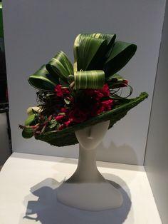 A hat made of flowers! At Philadelphia Flower Show! Contemporary Flower Arrangements, Unique Flower Arrangements, Unique Flowers, Beautiful Flowers, Exotic Flowers, Purple Flowers, Deco Floral, Giant Paper Flowers, Flower Hats