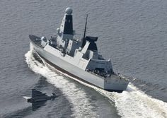 A Eurofighter flying low over the HMS Daring