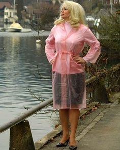 Pink Raincoat, Plastic Mac, Hands On Hips, Apron Dress, Rain Wear, Wrap Dress, Tights, Lady, Unique