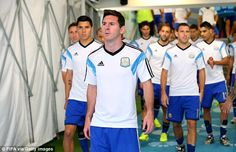Striding out: Messi leads out the Argentina side as they go to warm-up ahead of the game.