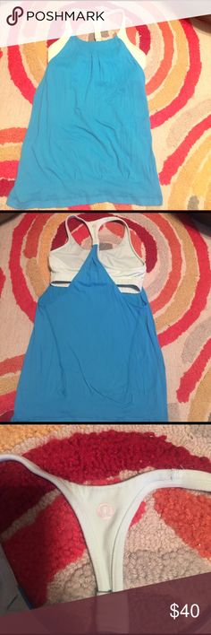 Lululemon flow top Lululemon blue size 6 blue top. Worn a handful of times. Attached inner bra. lululemon athletica Tops Tank Tops