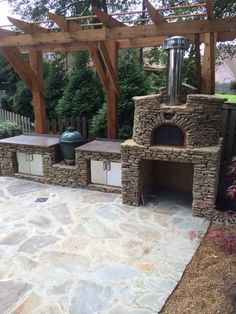 A new outdoor kitchen finished up! Complete with a wood fired oven & egg grill. Lots of counter space and cabinet storage below. Outdoor Kitchen Cabinets, Outdoor Kitchens, Kitchen Decor, Eggs In Oven, Kitchen Utensils Store, Backyard Renovations, Stone Masonry, Wood Fired Oven, Cabinet Decor