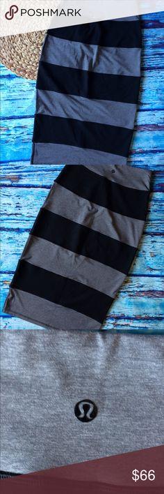 "Lululemon Yoga Over Skirt Black & Soot Gray 4 Fantastic pre-worn skirt, light wear.  Size 4, measurements are approximately; 24"" waist, 33"" hips, 29.5"" length. No trades. lululemon athletica Skirts"
