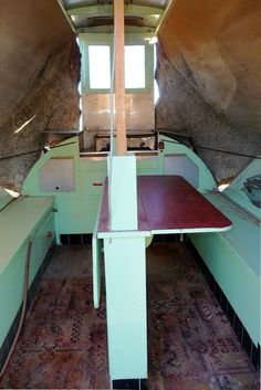 1951 travel trailer Folding table. I wonder how this could be incorporated into the bench seating as a sleeper conversion??