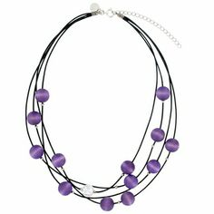 A galaxy of wooden beads dyed violet are suspended from four waxed-cotton cords, captured in space by silver metal stoppers. aarikka Vilkas Lilac Necklace  - $68