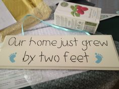 """New baby boy sign. Very cute! """"Our home just grew by two feet"""""""