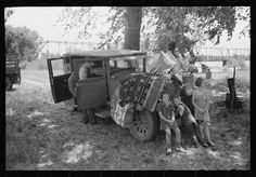 Camp of migratory workers in Arkansas River bottoms, Muskogee County, OK, 1939. Library of Congress FSA/OWI photograph collection.