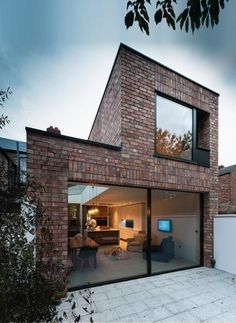 Providing a large, bright room to bring the outside in at ground floor level, this two storey extension also provides additional bedrooms and bathrooms at first floor level. The minimal framed glass screens open full width to the rear garden area from the kitchen area...