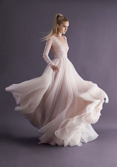 Paolo Sebastian's signature petal skirt paired with a lace-sleeved bodice and plunging neckline