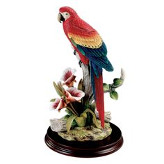Bring the tropical rainforest into your home with this vibrant Scarlet Macaw with Orchids Sculpture. $40.00
