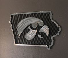 """This unique handmade piece of art makes a great gift for any Iowa Hawkeye Fan's home, office, bar, man cave, garage, dorm room, etc.  A handmade, licensed Trademark product of the University of Iowa.  Dimensions: 16"""" x 24""""  Finish: Ground metal with a durable eco-friendly clear coat to protect against rusting.  This product is recommended to be used indoors only unless otherwise specified."""