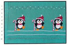 Smocking plate with three penguins and candy canes. 10 rows of smocking on a yoke.