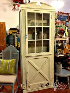 Exhibit favorite knickknacks in a door-turned-display-cabinet.