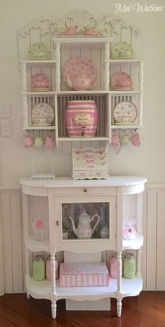 My shabby chic plate rack and pink lemonade decanter by Two's company :)