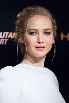 Jennifer Lawrence's carefully poised flyaways have got us reconsidering the classic updo