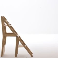 Scala Zero is a multifunctional wooden chair that transforms into a small stepladder with one easy motion.