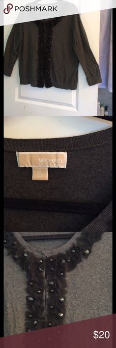 Michael Kors cardigan Beautiful lightweight MK cardigan in dark gray will be the perfect addition to your LBD. Trimmed in sheer black frayed petals and shiny black beads give texture and interest to the garment. Hardly worm, no pilling, tears or snags. Been stored in closet of pet-free, smoke-free home. MICHAEL Michael Kors Sweaters Cardigans