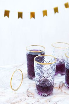 DIY gold-rimmed drinking glasses | freckleandfair.com