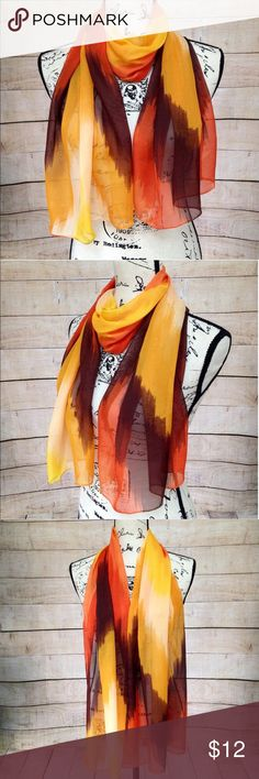 """Orange Yellow Brown Cream and Red Scarf Lightweight scarf featuring bright orange, brown, cream, yellow and red colors. 100% silk feeling polyester. Measurements: 19"""" x 61"""". NWT. Accessories Scarves & Wraps"""