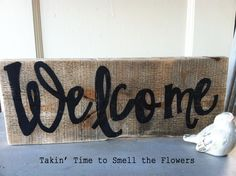 Rustic Shabby Farmhouse Salvaged Pallet Wood Handpainted Welcome Sign. $12.00, via Etsy.