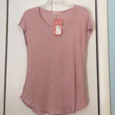 Soft pink waffle tee brand new with tags Adorable waffle tee in a soft pink color.  Tee is lightweight with cap sleeves and curved flattering waist! Smoke free home never worn! Tea n Rose Tops Tees - Short Sleeve