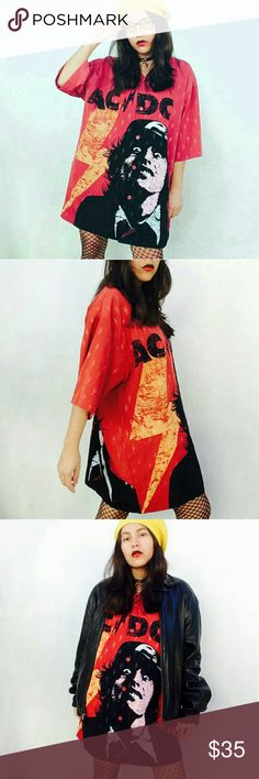 """Vtg y2k AC/DC grunge rock killer graphic tee Dope Vtg Y2K AC / DC shirt, size XL. Brick red / mustard / black combo with thunderbolts all over.  This is a male shirt, but girls can slay this too ? I wore it as an oversized mini dress. This pup is a serious headturner ;]  Measuraments (taken flat):  Shoulders 21"""" Length 30"""" Sleeves 11""""  No trades Cool discounts on bundles    Vintage retro Y2K Ac/dc rock band long tee bolts thunder visual graphic grunge goth dark witchy demonia unif killstar…"""