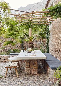Why Ca'n Busquera in Mallorca is the perfect holiday home Outdoor Dining, Outdoor Spaces, Outdoor Decor, Back Gardens, Outdoor Gardens, Garden Furniture, Outdoor Furniture Sets, Stone Bench, Outdoor Retreat