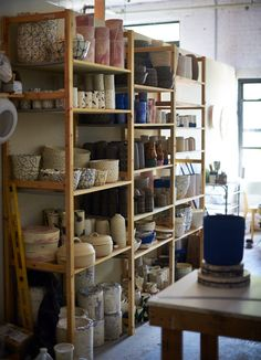 """""""The main thing I do when I'm in the studio is fill up these shelves,"""" he says. """"I get a little uncomfortable when they aren't at full capacity, so I keep working."""" For him, """"working"""" involves nearly 30 hours a week at the potter's wheel, throwing the painted vases and cups he's become known for since he (officially) launched Workaday Handmade in 2013."""