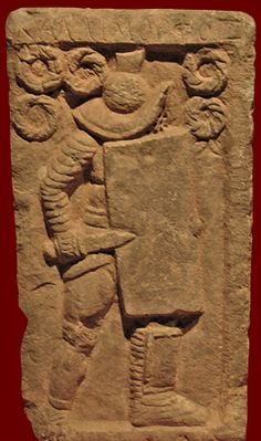 The wreaths on a tombstone from Ephesus indicate that this Murmillo won many combats. Tombstone of a Murmillo gladiator, Roman, from the gladiator graveyard in Ephesus, second-third century CE. The gladiator wears a helmet with high crest, a padded arm-protector, and one short shin-guard; he carries a large curved rectangular shield and stabbing sword (gladius). Selçuk, Turkey, Ephesus Archaeological Museum.