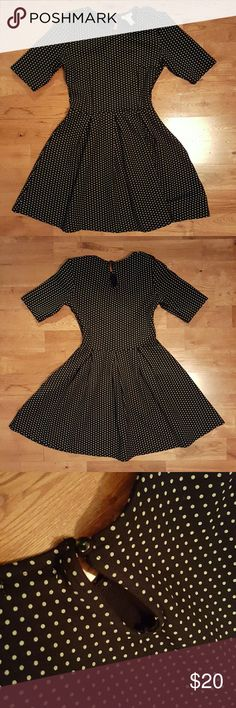 Forever 21 Vintage Dress Never used Vintage style dress Black with white polka dots Fit and flared Keyhole back Elbow length sleeves Shoulder straps (as seen on 4th picture) Thick, scuba-type fabric Very stretchy Hits above knee/mid thigh Size S but fits like an XS.  Good for winter (holiday events), since fabric is thick.  Don't comment your offer, send it via the offer link. Remember you can also make offers on bundles.  Clean home, smoke-free/no furry friends inside Forever 21 Dresses