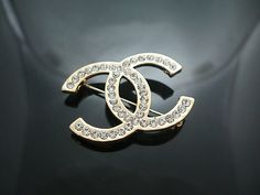 I need a Chanel brooch to Instantly make any outfit look more chic/expensive.
