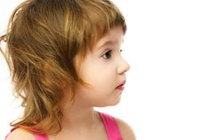 Short bangs and a layered haircut frame the face and keep hair out of your toddler's eyes for longer.
