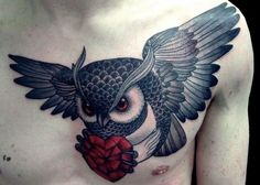 A cool tattoo in red and black of a flying owl carrying a red crystal heart. Because the owl is believed to be wise, whatever it chooses to carry is given great importance. A heart made of crystal is precious and fragile, so this tattoo asks the viewer to be wise and treat this guy's heart with care.