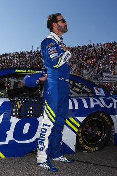 Jimmie Johnson, driver of the #48 Lowe's Chevrolet, stands for the national anthem during pre-race ceremonies for the Monster Energy NASCAR Cup Series ISM Connect 300 at New Hampshire Motor Speedway on September 24, 2017 in Loudon, New Hampshire.