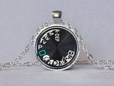 CAMERA PENDANT Camera Dial Pendant Black White Green Photography Pendant Camera Jewelry Photographer Gift. $14.25, via Etsy.