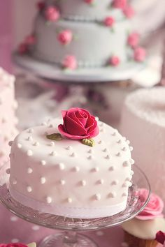 White heart shaped spotted cake with sugar rose