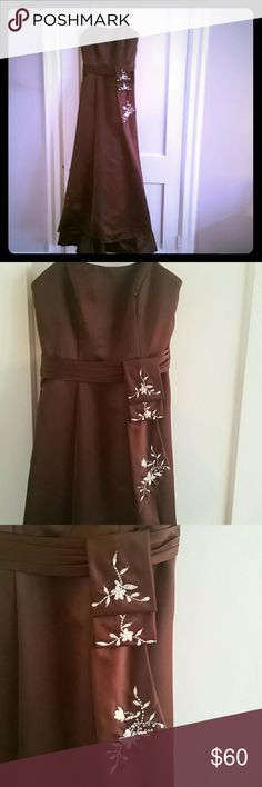 "Long chocolate brown formal dress Dark brown special occasion dress with asymmetrical waist embellishment. Size 6, alteration to length. Skirt is slightly hi-lo.    Measurements: bust 15.5"" waist 13""  (flat) Waist to hem (front) 40"" Waist to hem (back)  48"" Alfred Angelo Dresses"