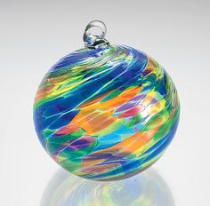 """Calypso"" #art glass #ornament by Michael Trimpol. Dazzling tropical hues create a blown glass ornament with perfect rhythm and harmony. An Artful Home exclusive."