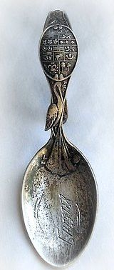 engraved, curved handle baby spoon with stork ca. 1900