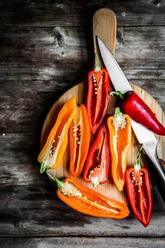 Colorful peppers on rustic background by Alena Haurylik - Photo 114517087 - Raw Food Recipes, Mexican Food Recipes, Chile Picante, Dark Food Photography, Rustic Background, Food Backgrounds, Fresh Fruits And Vegetables, Stuffed Hot Peppers, Belle Photo
