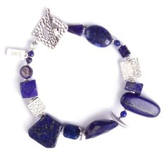 $AUD 99, free global shipping & returns , OOAK!  N°241 The Lapis Lazuli Wanderlust Statement Bracelet Lapis Lazuli, the eternal favourite of pharaohs, Dutch painters and 21st century women alike has been given a contemporary makeover in this single-strand bracelet. Luscious Lapis Lazuli sourced from four different countries, with varying levels of rawness and pyrite golden specks (fools' gold) needs nothing more than cool smooth silver to show off the incredible beauty of this stone.
