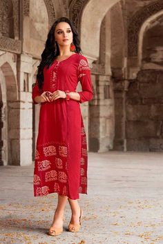 Take Away This Matchless Red Aline Rayon Party Wear Kurti Design For Female. This Latest Fancy Style Tunic Contains Sleeves, V-Neck & Crafty Print. Indian Dresses, Indian Outfits, Indian Clothes, Party Wear Kurtis, Tunics Online, Tunic Designs, Kurti Collection, Red Party, Indian Ethnic Wear