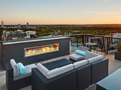 University Towers' rooftop deck with a gorgeous view of the gorgeous ATX. Makes me wanna snuggle up with a good book next to that fire.