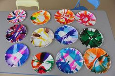 Brush a paper plate with hair gel, put paper plate in a salad spinner, squirt on a few colors of paint, spin.  Beautiful!