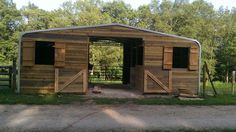 shedrow barn with tack room and hay storage - interesting use of a pre-fab roof