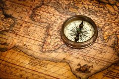 Image of 'Old vintage compass on ancient map'