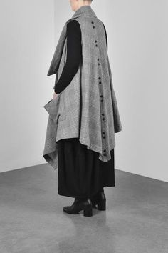 Oversized drape Vest with asymmetrical collar and slouchy pockets. Centre Back button details. Front button and loop closure to create drape. 76% Wool 23% Cotton 1% Nylon. Fabric Made in Japan Dry Clean Only (P) Designed and Made in Melbourne EW18-1310FG Complete the Look with the Salisbury Tunic, Leggings and Furla B